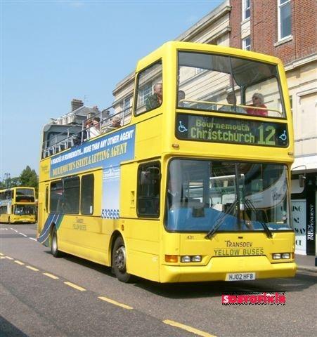bournemouth,england,travel to england,yellow bus