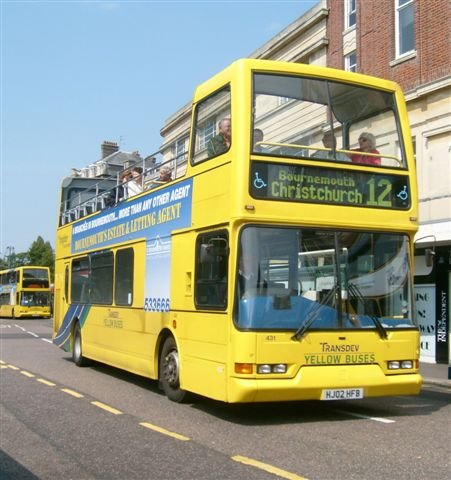 bournemouth,england,travel to england,yellow bus
